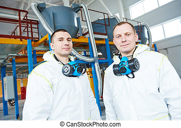 chemical industry workers at factory - two chemical industry...
