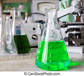 Chemical laboratory - Flask with a chemical solution in the...