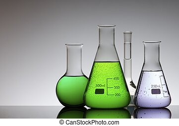 lab - chemical laboratory flasks with colored liquid inside