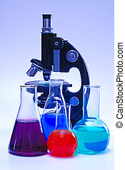 chemical laboratory glassware and microscope