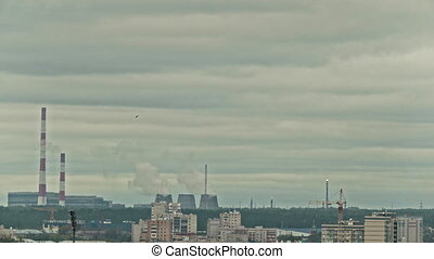 Chemical plant on city skyline - vapor and smoke from...