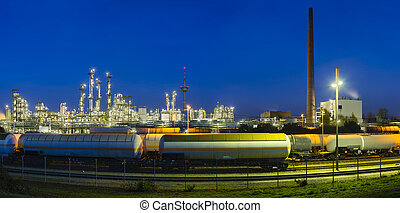 Chemical Plant Panorama At Night - Panoramic view of a...