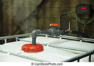 Chemical Pump Hydrochloric Acid - A wand pump leads into a...