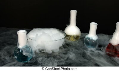 Chemical reaction flasks - Steaming and boiling liquid in...