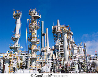 Chemical Refinery - puffs of polluting smoke from a...