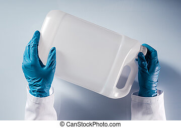 Chemical scientist opening white unlabeled plastic tank canister