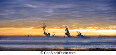 Chemical skyline - Sunset over a chemical plant, situated...