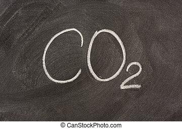 chemical symbol for carbon dioxide on a blackboard -...