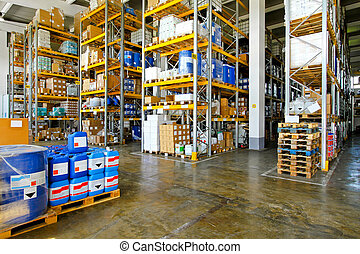 Warehouse with chemical liquids in cans and barrels
