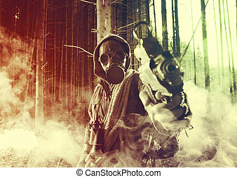 Chemical warfare - Soldier wearing a gas mask pointing a gun