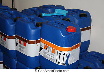 A stack of blue chemical containers in stock