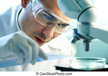 Chemist at work - Serious clinician studying chemical...