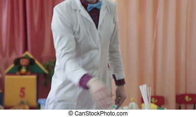 Chemist mixes medicines - Young scientist using pipette to...