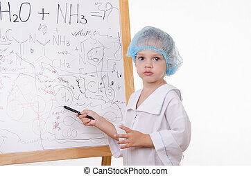Chemist points on the board to scrawl