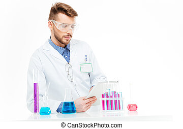 Chemist using tablet computer