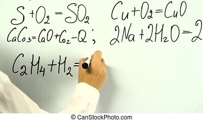 Chemistry formula on white board written by female hand...