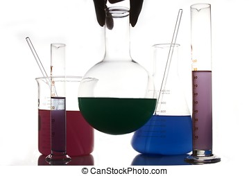 Chemistry glassware - A hand holding a chemistry glassware...