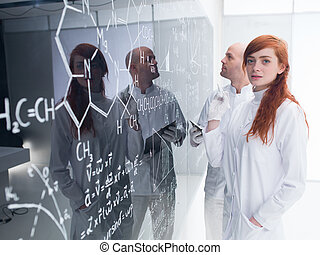 chemistry lab teacher analysis - side-view of a teacher in a...