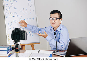 Chemistry teacher explaining formulas