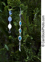 chep bracelet bijoux on a coniferous tree twigs image
