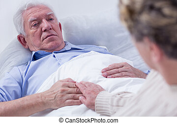 Cherishing their last moments together - Close-up of a dying...