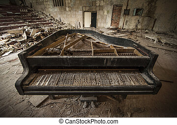 Chernobyl - close-up of an old piano in an auditorium -...