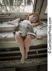 Chernobyl - Doll placed near a window - Old bent doll placed...
