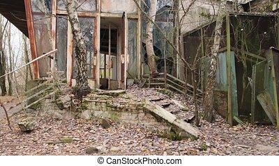 Chernobyl zone, Ukraine. Visit to Pripyat Ghost Town - 4K Panning former abandoned restaurant and supermarket building 2020