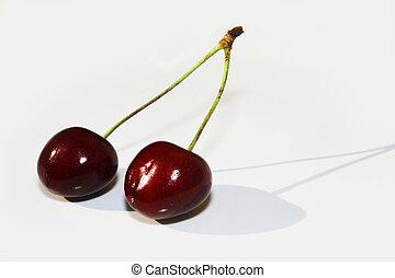 Cherries against white background
