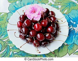 Cherries and flower