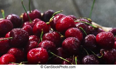 Cherries. Cherry. Cherries in color bowl and kitchen napkin....
