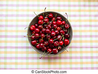 Cherries in a bowl on marble table