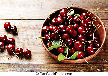 Cherries in a clay plate