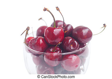 Cherries in a glass bowl isolated on white
