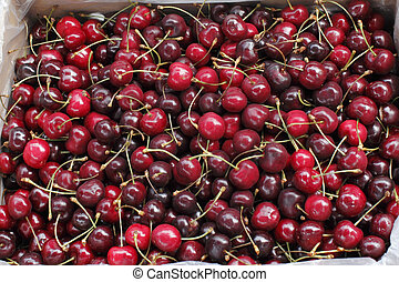 Cherries in a Market Bin