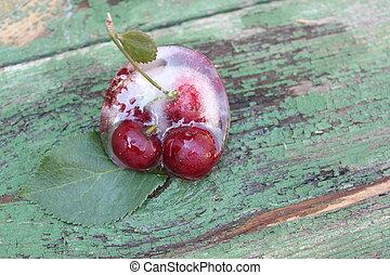 Cherries in ice. Frozen fruits.