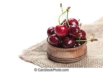 cherries in wooden bowl close-up
