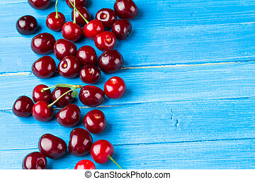 Cherries on a blue wooden background