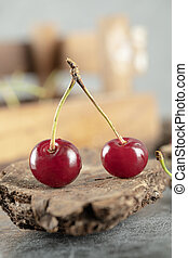 Cherries on a piece of wood