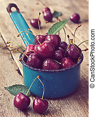 cherries on a wooden background