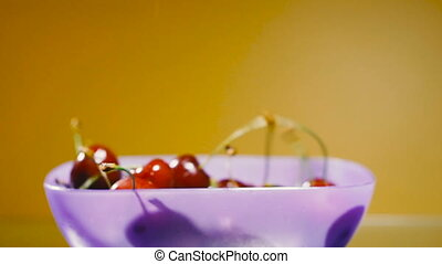 Cherries. Sweet cherry falls into the plate