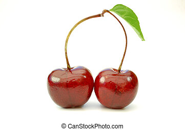 Two cherries with a leaf