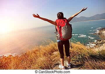 cherring hiker seaside mountain - hiking woman stand ...