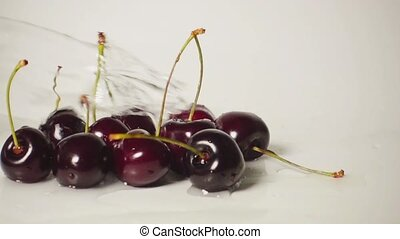 Cherry and water splash, slow motion