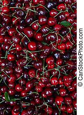 Cherry Background. Sweet organic cherries on market counter