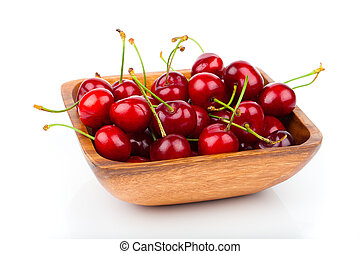 cherry berry in wooden bowl, isolated on white background