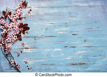 cherry blossom on rustic wooden backkground