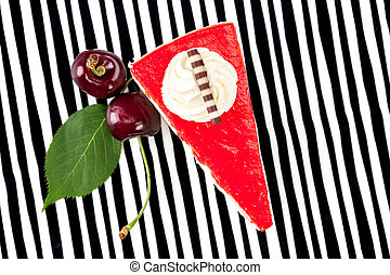Cherry cake on striped background from above