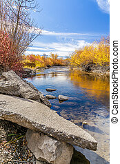 Cherry Creek running through the beautiful autumn landscape of Cherry Creek Nature Preserve on the outskirts of Bozeman, Montana