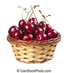 Cherry in a wicker basket isolated on white